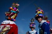 Men dressed in a traditional carnival costume walk from house to house during the traditional folklore carnival parade on March 1 2014 in Vortova...