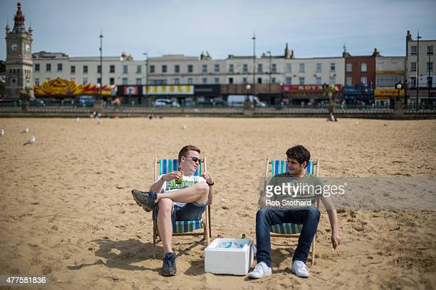 Men drink beer on deck chairs on the beach on June 18 2015 in Margate England The county of Kent was placed top on a list of Europe's best family...