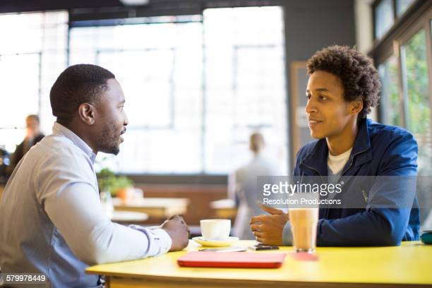 Men drinking coffee in cafe