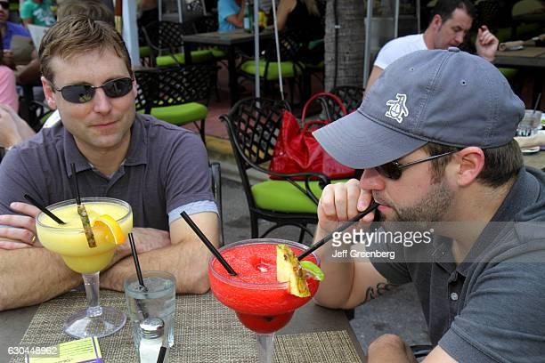 Men drinking daiquiris at the Art Deco Weekend festival