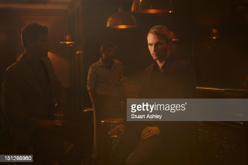 Men drinking in whiskey bar : Stock Photo