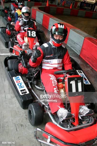 Men driving go karts at the Grand Prix Allsports Hi Speed Indoor Kart Racing