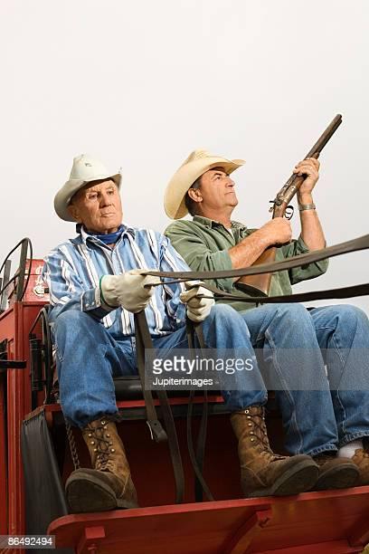 Men driving horse-drawn coach