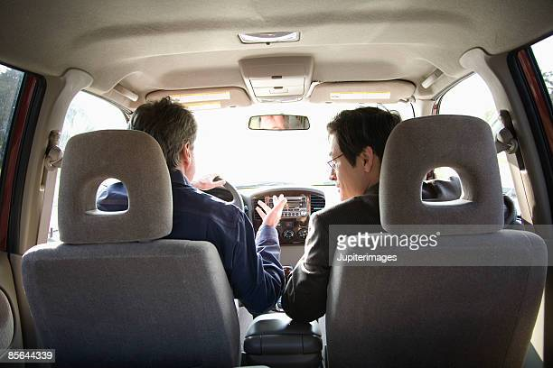 Men driving in car together