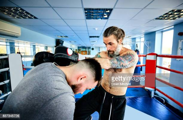 Men during kickboxing fight at health club