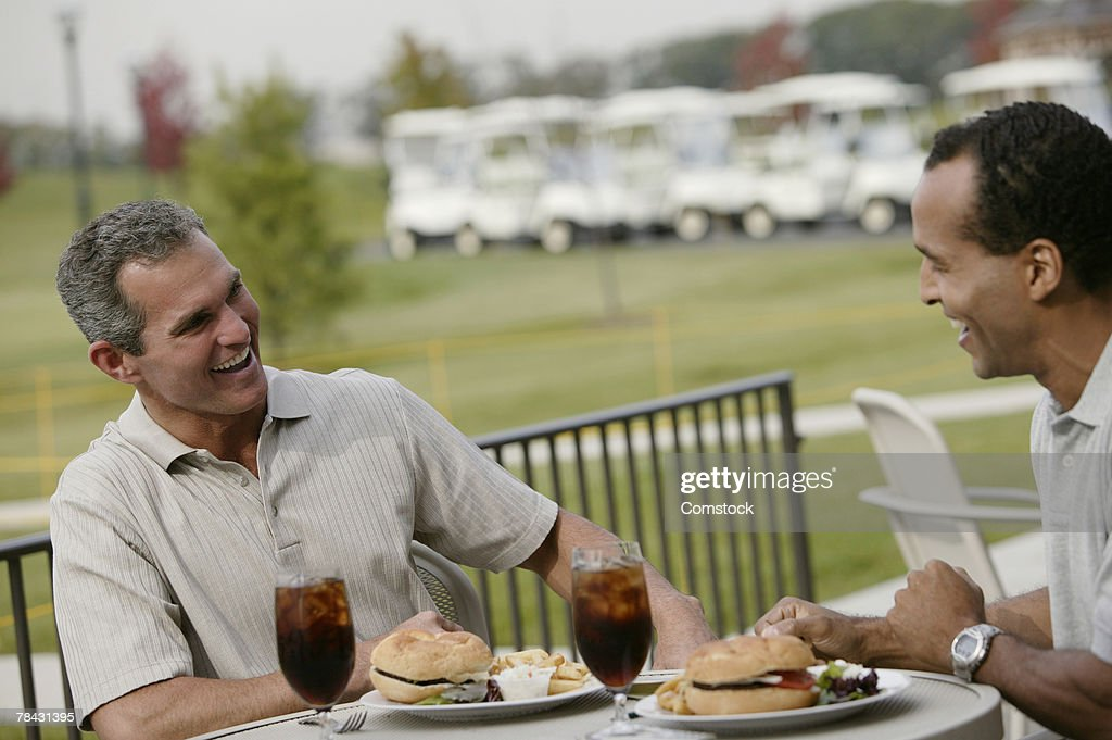 Men eating at country club