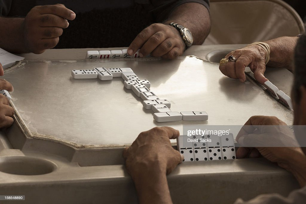 Men enjoying dominos : Stock Photo