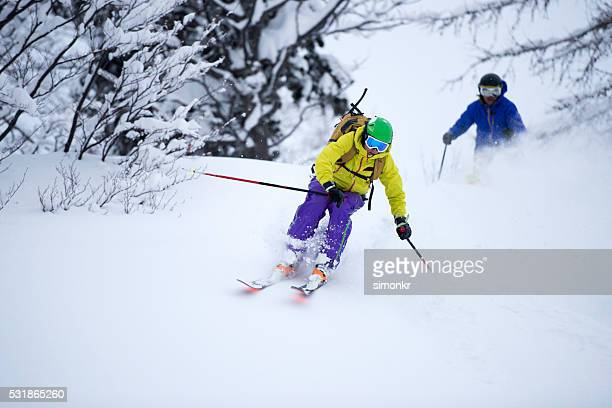 Men enjoying skiing