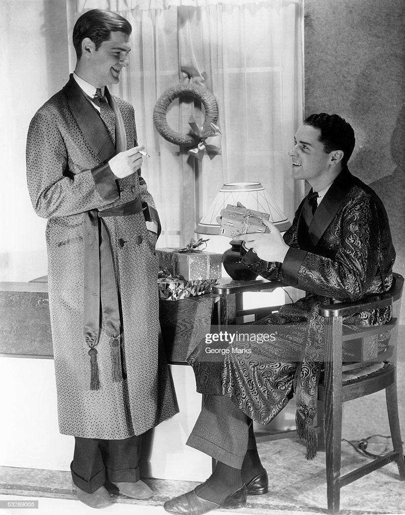 Men exchanging presents : Stock Photo