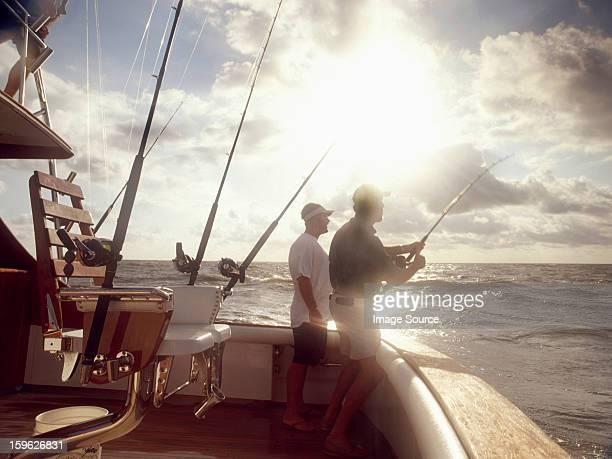 Men fishing from sport fishing boat