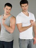 Men flexing muscles