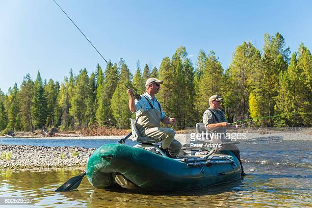 Men fly fishing in a boat, British Columbia