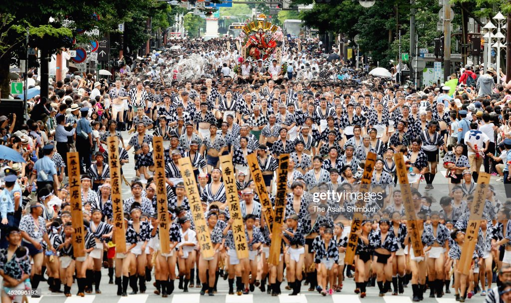 Men from all seven groups run with 'kakiyama' floats during the 'Shudan Yamamise' as a part of the Hakata Gion Yamakasa festival on July 13, 2014 in Fukuoka, Japan. The finale of the Hakata Gion Yamakasa festival, locally referred to as 'Oiyama,' was held in the early morning of July 15.