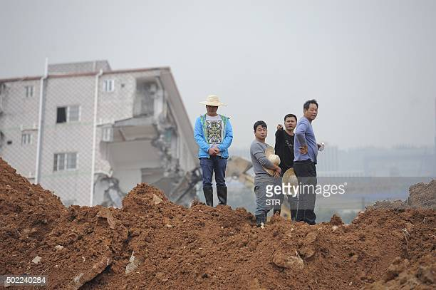 Men from central China's Hunan province to look for their missing relatives at the site of a landslide that hit an industrial park in Shenzhen in...