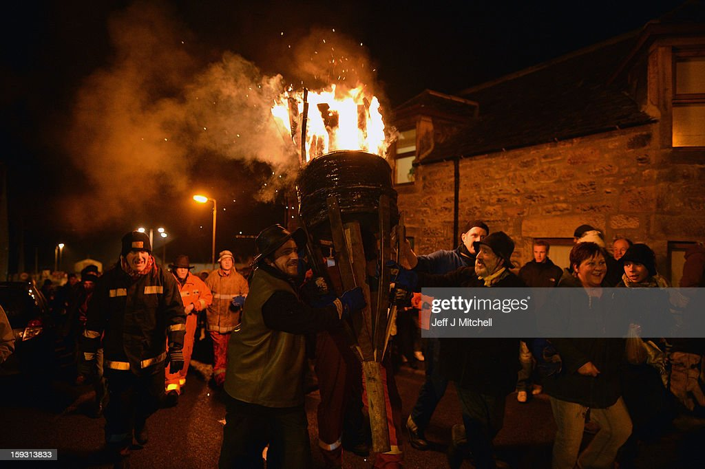 Men from the Clavie Crew carry a burning barrel on the top of a pole, packed with tar soaked sticks on January 11, 013 in Burghead, Scotland. The burning of the Clavie takes place on January 11 each year as local people welcome in the New Year with a fire ceremony, which has ancient roots believed to bring good luck for the coming year.