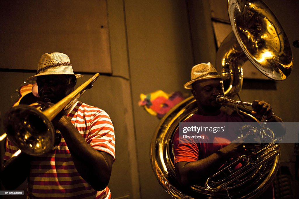 Men from the horn section of a samba group play during Carnival celebrations downtown Rio de Janeiro, Brazil, Monday, on Feb. 11, 2013. The festivities, which are expected to attract almost 900,000 visitors, precede the start of Lent, which begins with Ash Wednesday on Feb. 13. Photographer: Dado Galdieri/Bloomberg via Getty Images