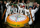 Men from the traditional Alkmaar Cheese weighing house celebrate their record 567 kilogram Dutch cheese April 27 2002 that entered the Guinness Book...