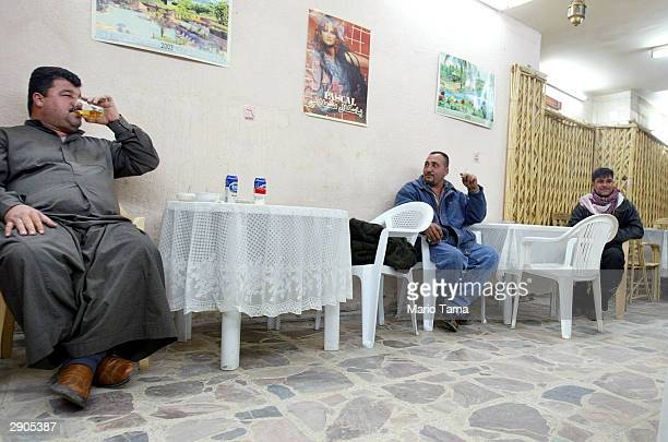 Men gather in AlKahaf or The Cave Bar January 27 2004 in Baghdad Iraq The bar serves beer and liquor and caters to men only Saddam Hussein closed all...