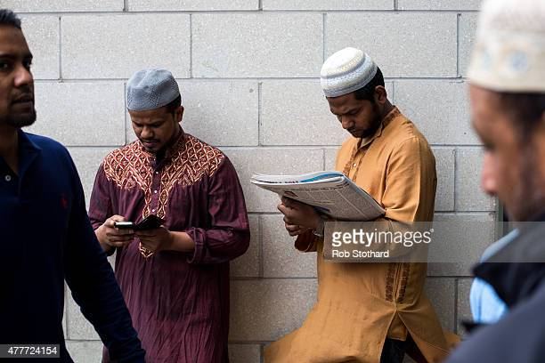 Men gather outside the East London Mosque before attending the first Friday prayers of the Islamic holy month of Ramadan on June 19 2015 in London...