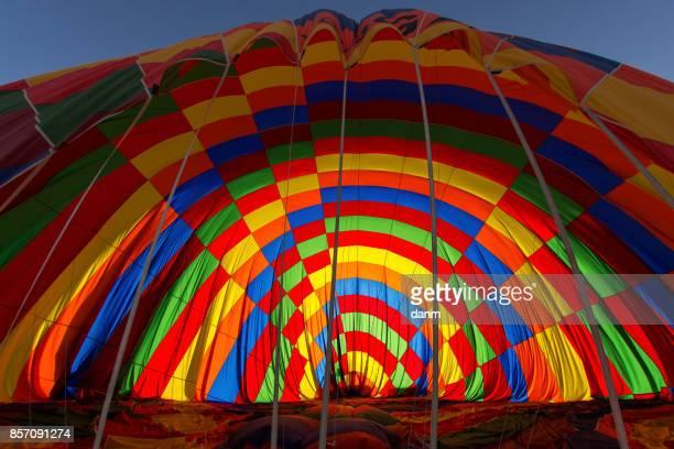 Men gathering the balloon after landing in Cappadocia, Turkey