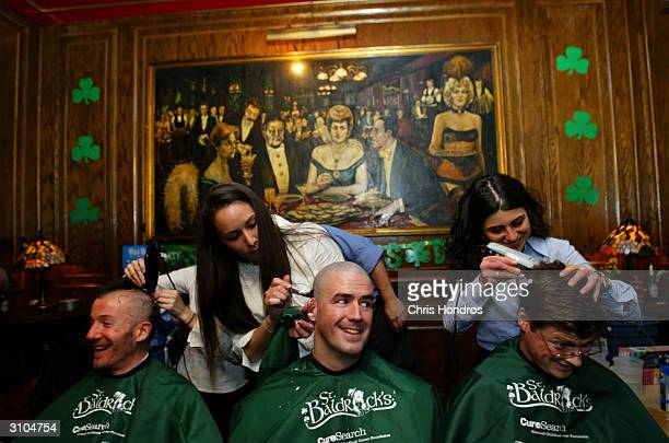 Men get their heads shaved during a St Baldrick's Day event at Jim Brady's Pub March 17 2004 in New York City The fiveyearold event challenges people...