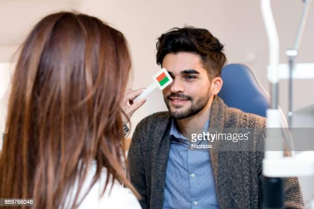 Men getting eye test by optometrist