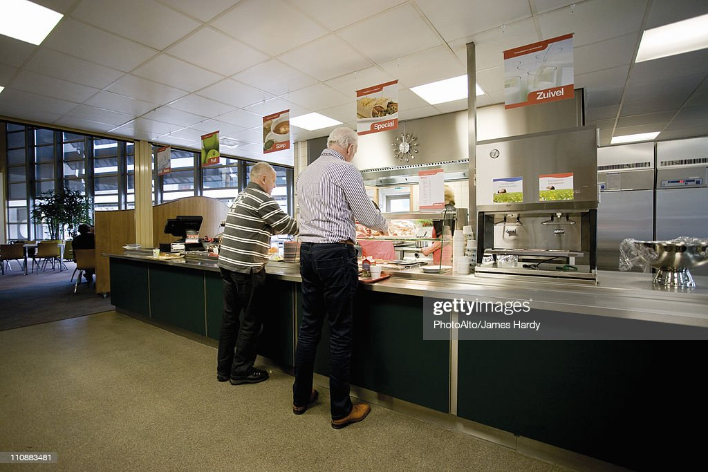 Men getting lunch in cafeteria : Stock Photo