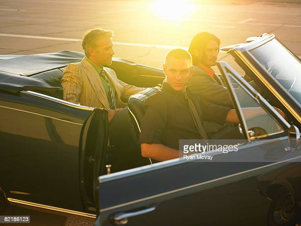 3 men getting out of car
