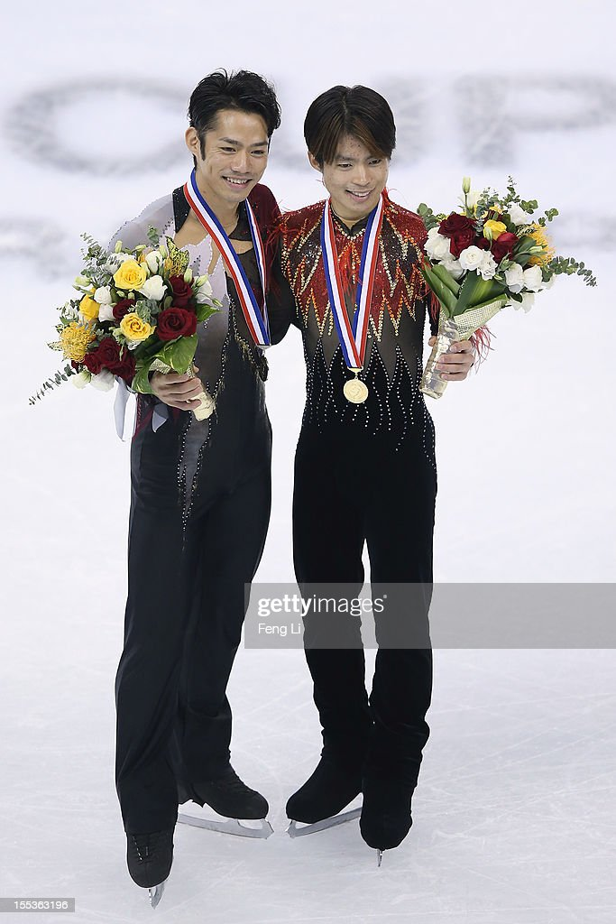 Men gold medalist Tatsuki Machida of Japan (R) and silver medalist Daisuke Takahashi of Japan (L) pose for photo during the medal ceremony of Cup of China ISU Grand Prix of Figure Skating 2012 at the Oriental Sports Center on November 3, 2012 in Shanghai, China.