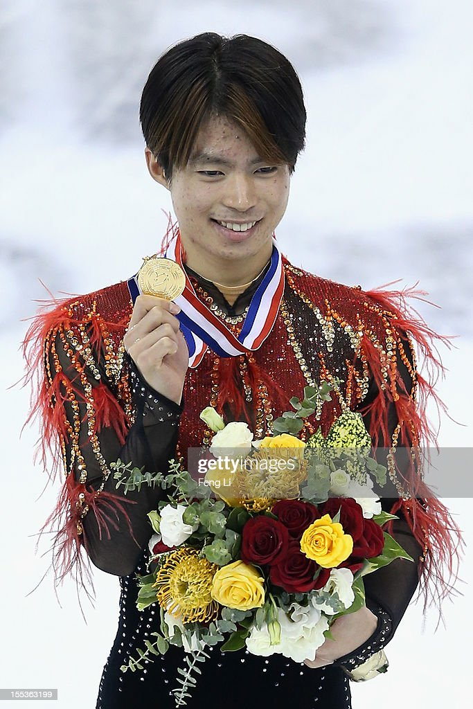 Men gold medalist Tatsuki Machida of Japan poses for photo during the medal ceremony of Cup of China ISU Grand Prix of Figure Skating 2012 at the Oriental Sports Center on November 3, 2012 in Shanghai, China.