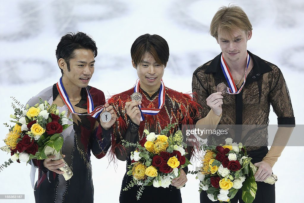 Men gold medalist Tatsuki Machida of Japan (C), silver medalist Daisuke Takahashi of Japan (L) and bronze medalist Sergey Voronov of Russia (R) pose for photo during the medal ceremony of Cup of China ISU Grand Prix of Figure Skating 2012 at the Oriental Sports Center on November 3, 2012 in Shanghai, China.