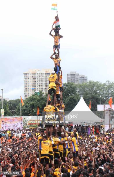 Men Govinda Mandal form human pyramid to break earthen pots on the occasion of Janmashtami at Borivali on August 15 2017 in Mumbai India The childgod...