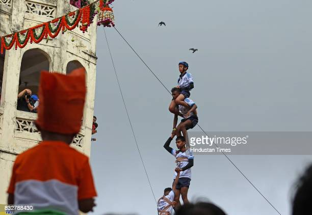 Men Govinda Mandal form human pyramid to break earthen pots on the occasion of Janmashtami at Dadar on August 15 2017 in Mumbai India The childgod...