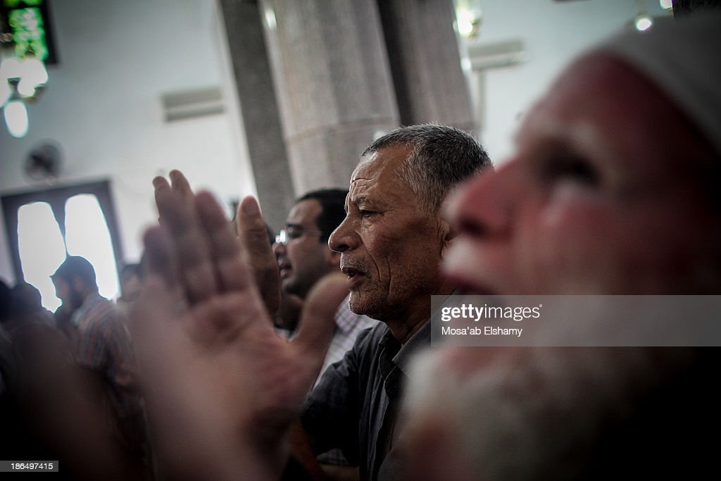CONTENT] Men grieve while praying at Iman mosque which was turned into a makeshift morgue following the violent dispersal of Rabaa Adaweya square and...