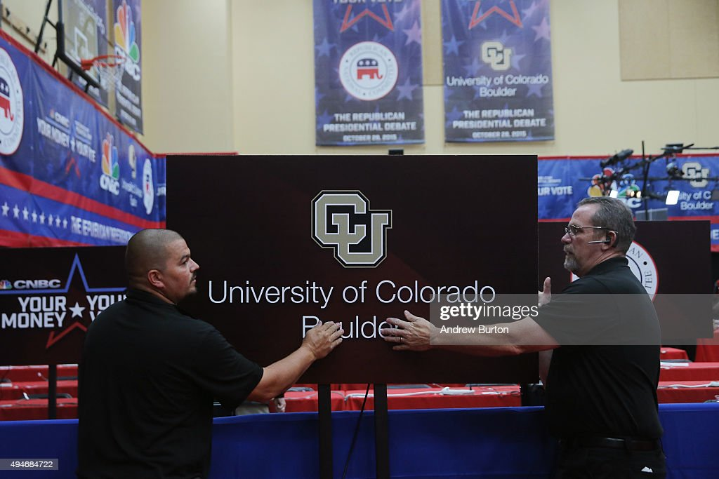 Men hang a University of Colorado Boulder sign in the spin room of the CNBC Republican presidential debate at the University of Colorado on October...