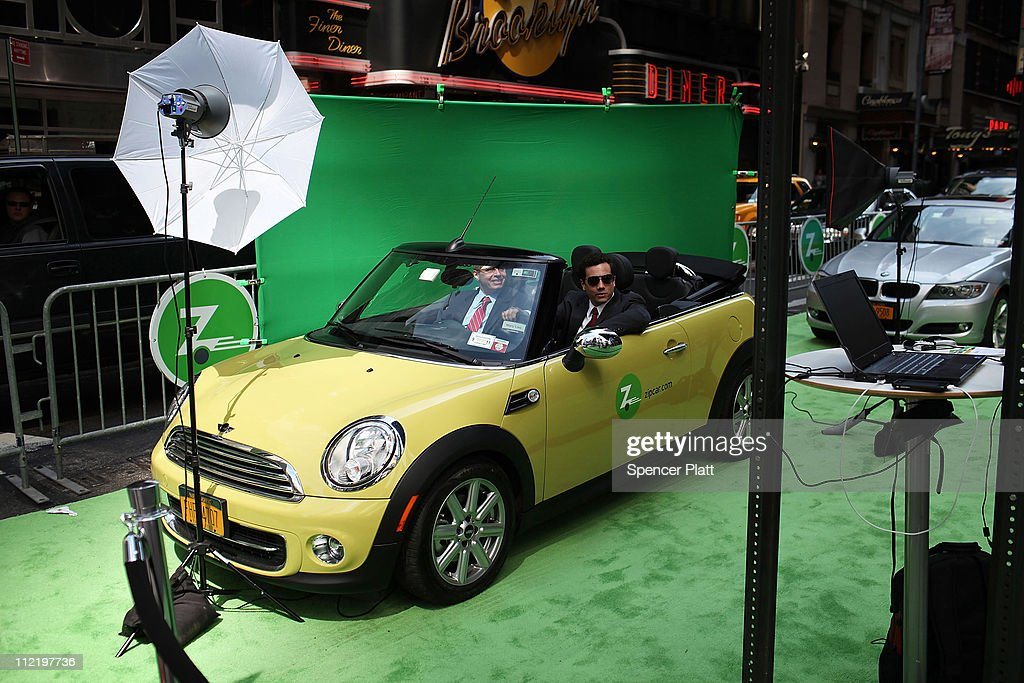 Men have their picture taken in a Mini Cooper Zipcar during a promotion of the short term car rental company on April 14, 2011 in Times Square in New York City. Zipcar debuted on the Nasdaq Stock Market Thursday under the symbol ZIP and saw its stock surge 67% on its first day of trading.