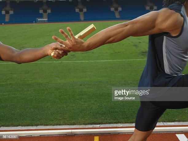 Men having a relay race