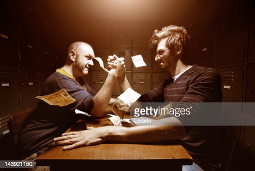 men having arm wrestling