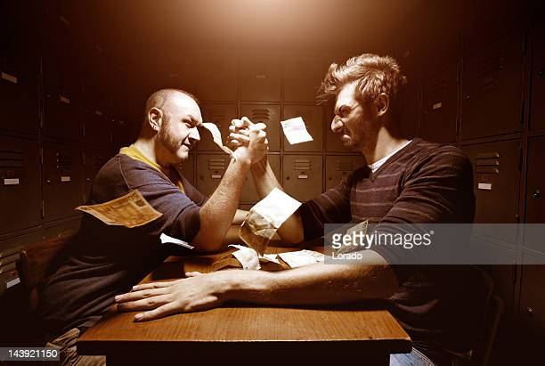 men having arm wrestling