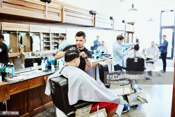 Men having hair cut in barber shop