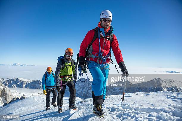 Men hiking on snow covered landscape
