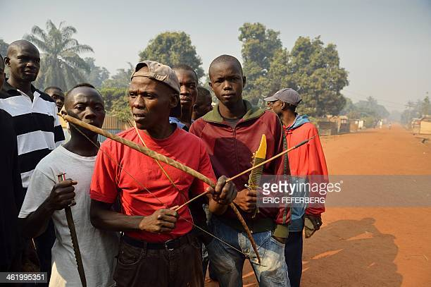 Men hold a baw arrows and knives as they want to protect themself from exSeleka members the eight's district of Bangui on January 12 2014 Rival...