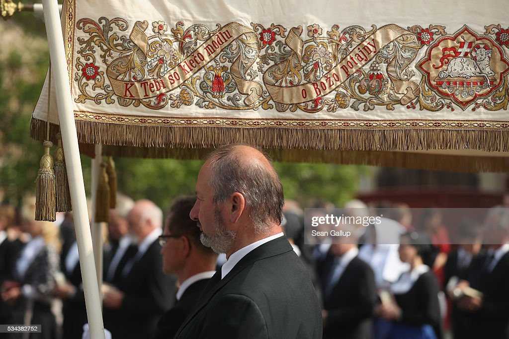 Men hold a canopy decorated and inscribed with texts in Sorbian during the annual Sorbian Corpus Christi procession through the village center on May 26, 2016 in Crostwitz, Germany. Sorbians are a Slavic minority in southeastern Germany who speak a language similar to Czech and Polish. Sorbian is still taughet in some schools in the region and a lively tradition of Sorbian literature, theater and folk culture has survived.