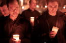 Men hold candles during an AIDS vigil December 1 2001 in Tompkins Square Park in New York City Since AIDS was first recognized in 1981 it has caused...