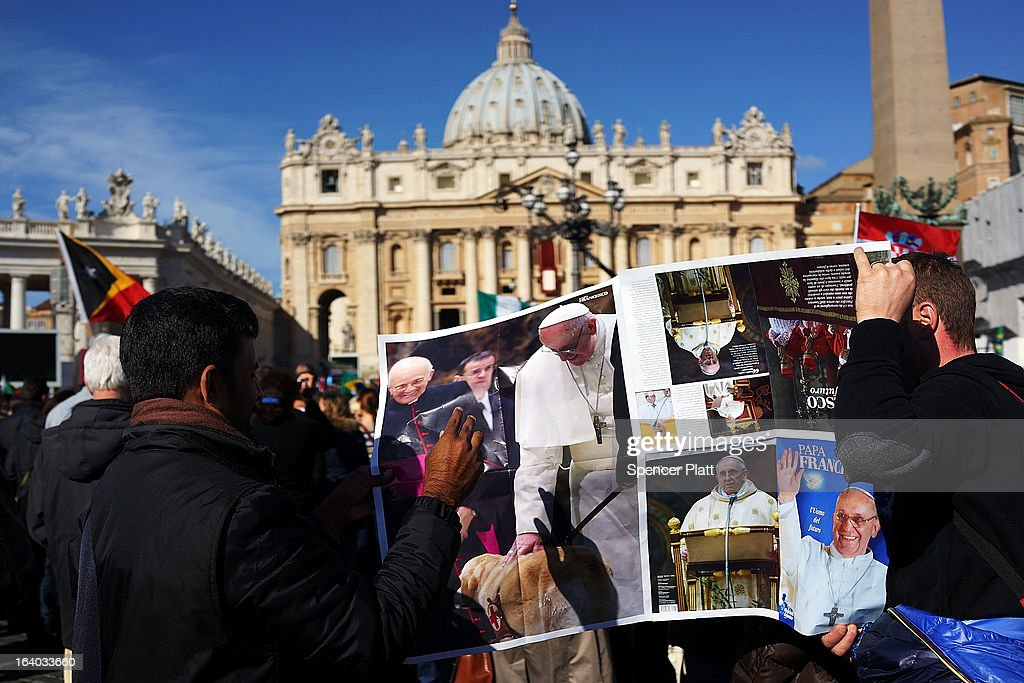 Men hold up a poster during the Inauguration Mass for Pope Francis in St Peter's Square on March 19, 2013 in Vatican City, Vatican. The mass is being held in front of an expected crowd of up to one million pilgrims and faithful who have filled the square and the surrounding streets to see the former Cardinal of Buenos Aires officially take up his role as pontiff.