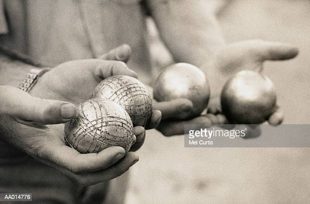 Men Holding Boules Balls