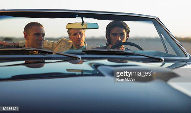 3 men in a car in desert
