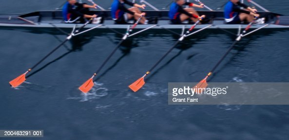 Men in boat rowing, elevated view