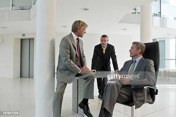 Men in business suits discuss