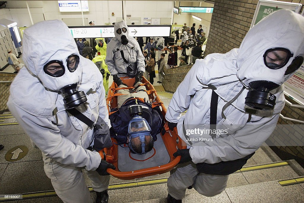 Men in chemical protection suits carry an injured person during a joint anti-terrorism drill conducted by Japan Ground Self-Defense Force, Police and Fire Department at Onomiya Station on November 17, 2005 in Saitama City, Saitama Prefecture, North of Tokyo, Japan. The drill conducted amid increased terrorism concerns was based on the scenario of a sarin nerve gas attack at a station.